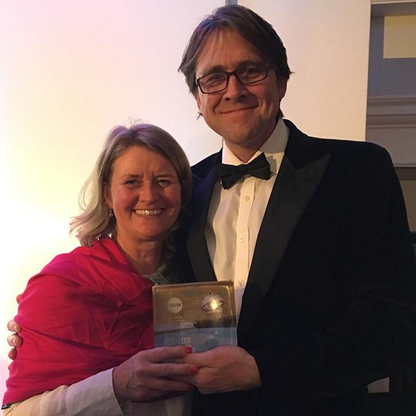 Julia Martin holding Silver Tourism Award