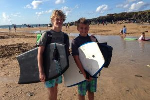 Two boys with body boards in Cornwall