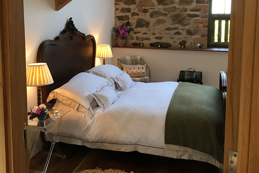 Antique double bed at romantic Bed and Breakfast