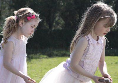 Girls in pretty dresses in a field