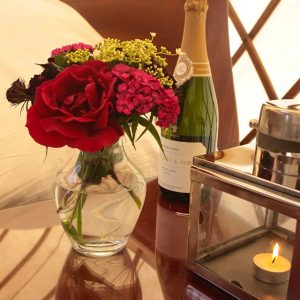 Flowers and champagne in a romantic yurt