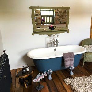 Relaxing blue roll-top bath