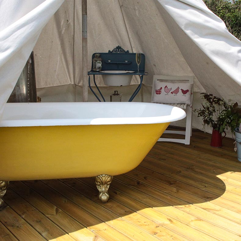 Relaxing roll top bath in Devon Yurt tent