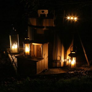 Hot tub at night covered in romantic candle light
