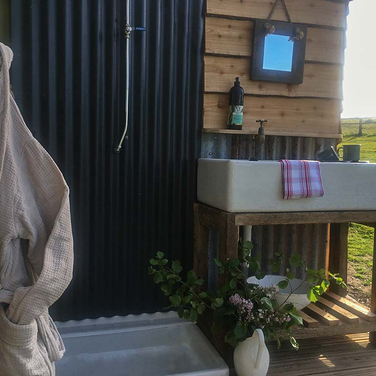 Great links outdoor shower and washing up area